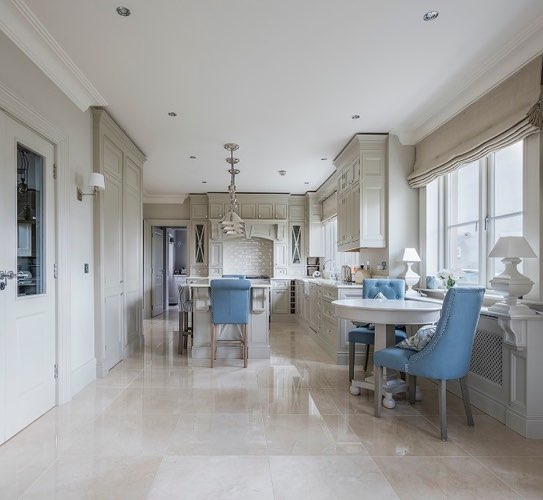 kitchen with crema marfil marble floor