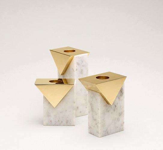 White marble candle holders with brass details.