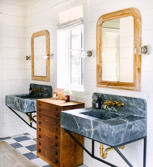Blue marble sink with gold plumbing fixtures