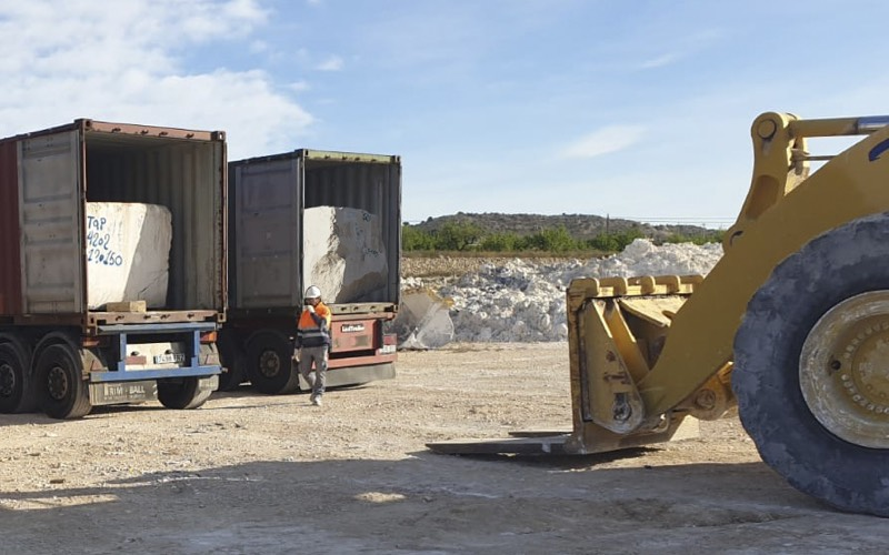 unload containers white travertine