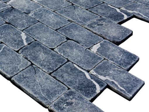 Mosaico de mármol negro